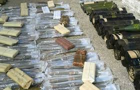 Photo of Authorities discovered a number of assault rifles, launchers, and large amounts of ammo In Homs