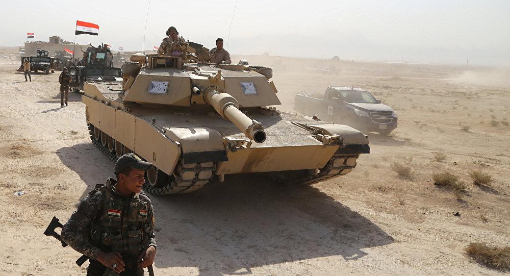 """Photo of تعزيزات عسكرية لقطع الطريق أمام """"داعش"""" بين العراق والأردن"""