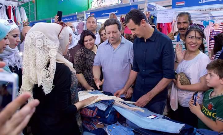 """Photo of الأسد يزور مهرجان """" صنع في سوريا"""" بالمزة"""