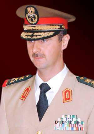 Photo of Commander-in-Chief of the Army and the Armed Forces, President Bashar al-Assad In a speech on the 72nd anniversary