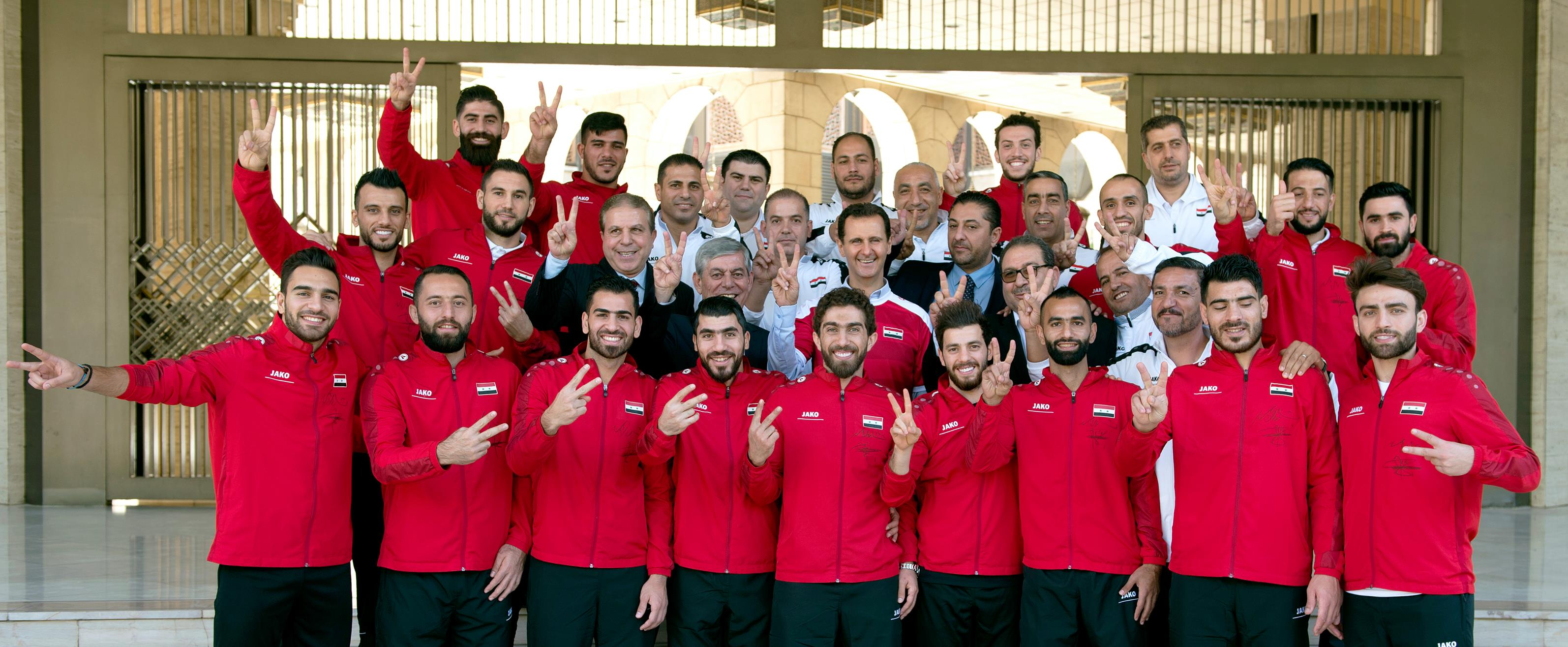 Photo of President Bashar al-Assad receives members of the Syrian National Football Team