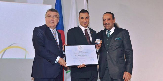 Photo of International Olympic Committee honors international swimmer Firas Mualla