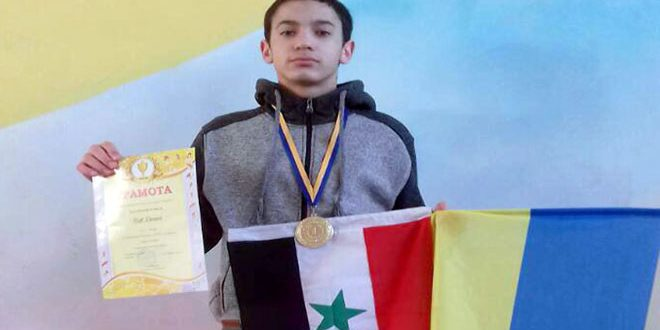 Photo of Syrian expatriate wins gold medal at Ukraine kickboxing championship