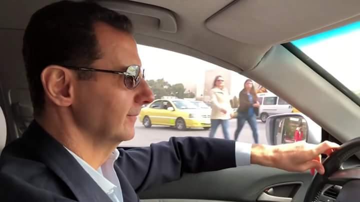 Photo of الأسد يقود سيارته بنفسه إلى الغوطة الشرقية (فيديو)