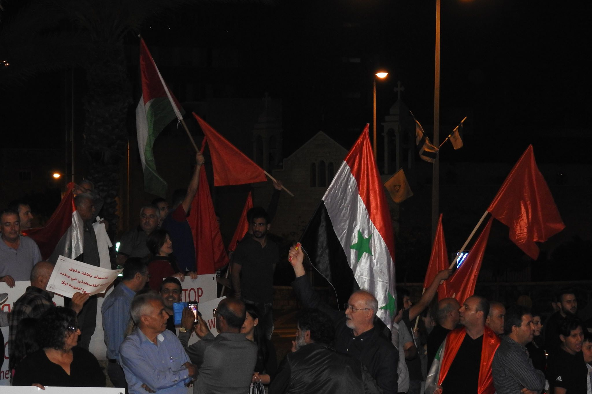 Photo of Hundred of people in front of the American consulate in Haifa denounce tripartite aggression on Syria and congratulation on the victory