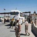 Eight buses carrying 448 terrorists and their family members exit Douma to be transported later to Jarablos