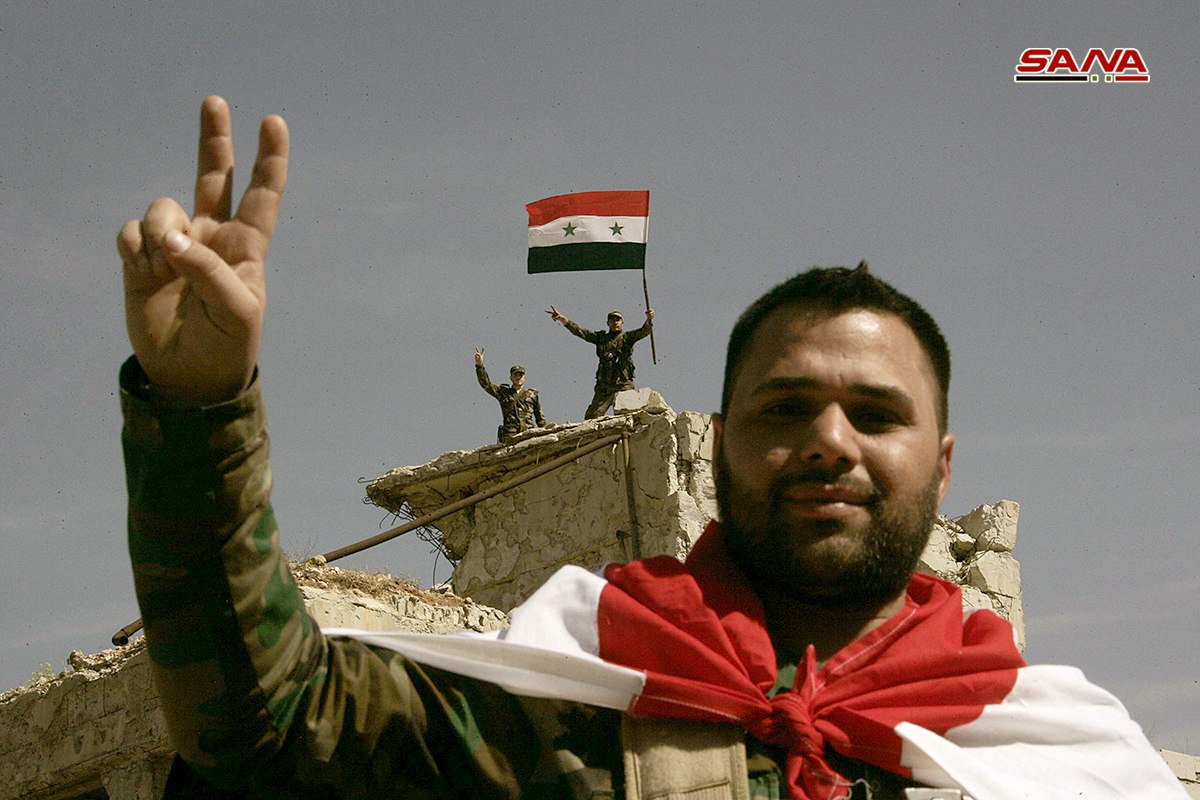 Photo of Syrian flag raised over Ain Tarma and Joubar after cleansing them of terrorism