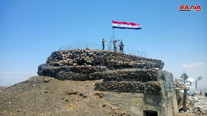 Photo of Syrian flag hoisted in Bosra al-Cham and al-Herak in Daraa countryside