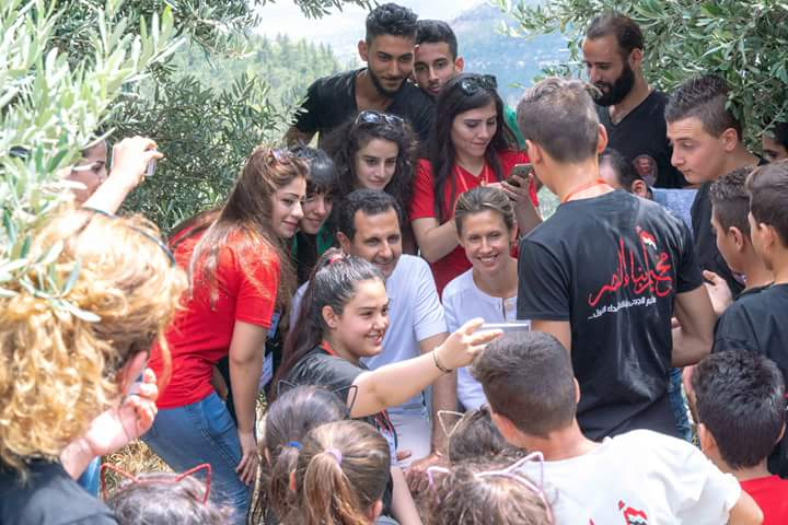 Photo of President al Assad and Mrs. Asmaa visit the camp of Abnaa al Nasr
