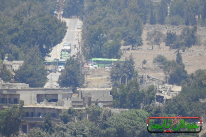 Fifty five buses transporting hundreds of terrorists and their families leave Quneitra countryside and head to the north of Syria