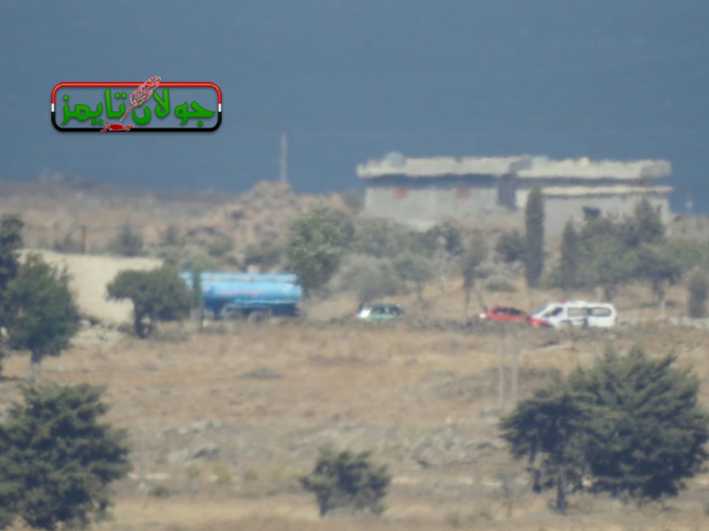 Photo of Preparations underway for evacuating second batch of terrorists from Um Batneh village in Quneitra countryside to northern Syria