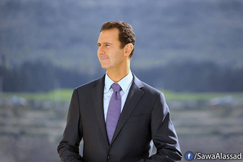 Photo of President al-Assad during video talks with President Putin
