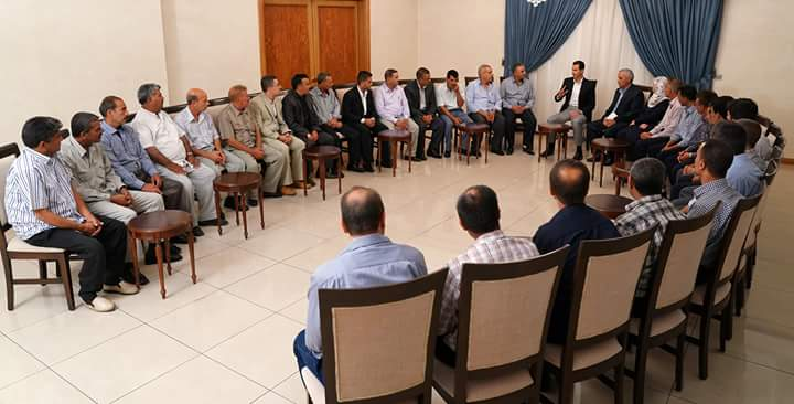 Photo of President  Bashar Al-Assad received the workers of Al-Rastan Cement Company