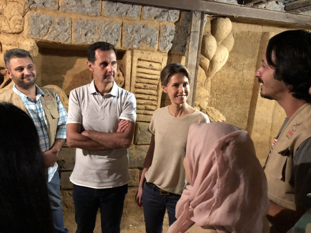 Photo of President al-Assad and Mrs. Asma visit one of Jobar's tunnels turned by artists to a place of art and creativity