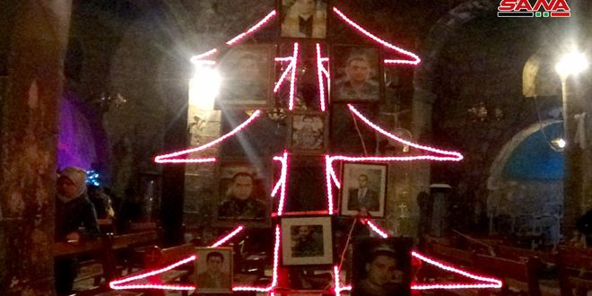 Photo of After eight year absence, Christmas tree lit up in Daraa