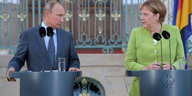 Photo of Putin and Merkel discuss developments in Syria
