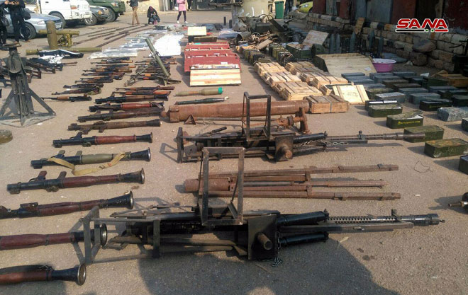 Photo of Weapons, ammunition found in farms of Daraa al-Balad