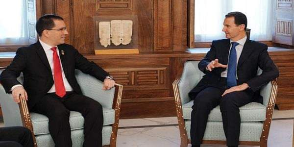 Photo of President al-Assad to Arreaza: What is going on in Venezuela is similar to what happened in Syria and it aims at controlling states