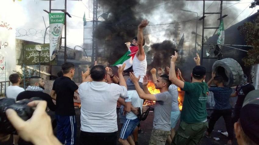 Photo of احتجاجات للعمال الفلسطينيين في لبنان