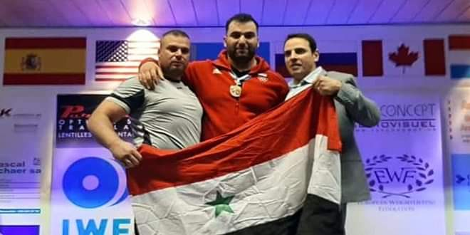 Photo of Syrian athlete gains golden medal in World Weightlifting Challenge Cup