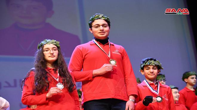 """Photo of برعاية """"سيدة الياسمين"""" حفل تكريمي للفائزين في منافسات الأولمبياد العلمي السوري"""