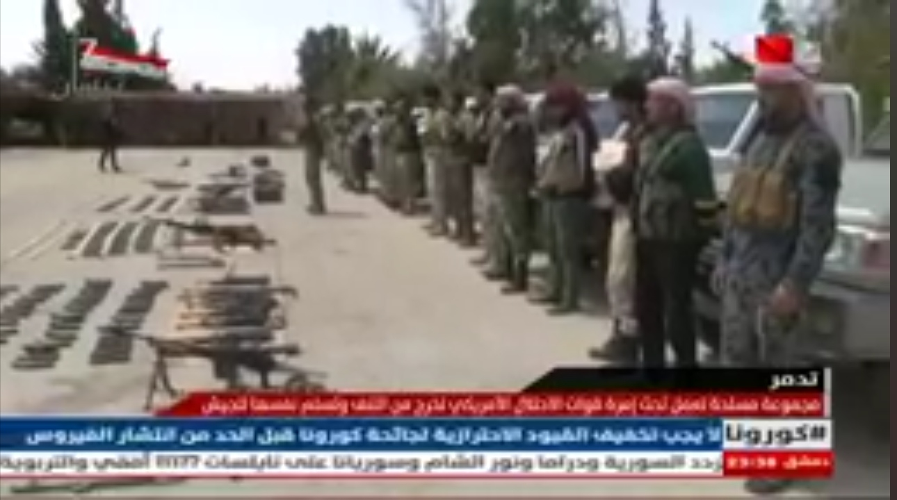 Photo of Armed groups working for the US hands over its weapons and equipment to Syrian Arab Army