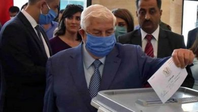 Photo of Foreign and Expatriates Minister Walid al-Moallem voted for the People's Assembly elections