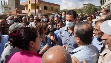 Photo of President al-Assad listens to Mashta al-Helou locals on extent of damage inflicted on them and their lands due to the fires