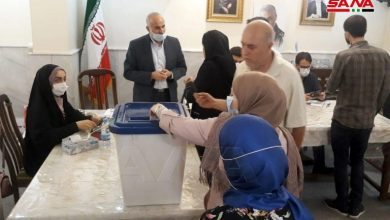 Photo of Iranians in Syria cast their votes in presidential election at the Iranian Embassy in Damascus